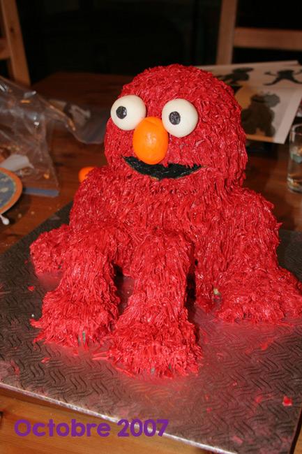 Elmo seated red cake
