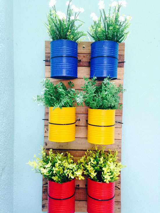 Vertical garden with cans