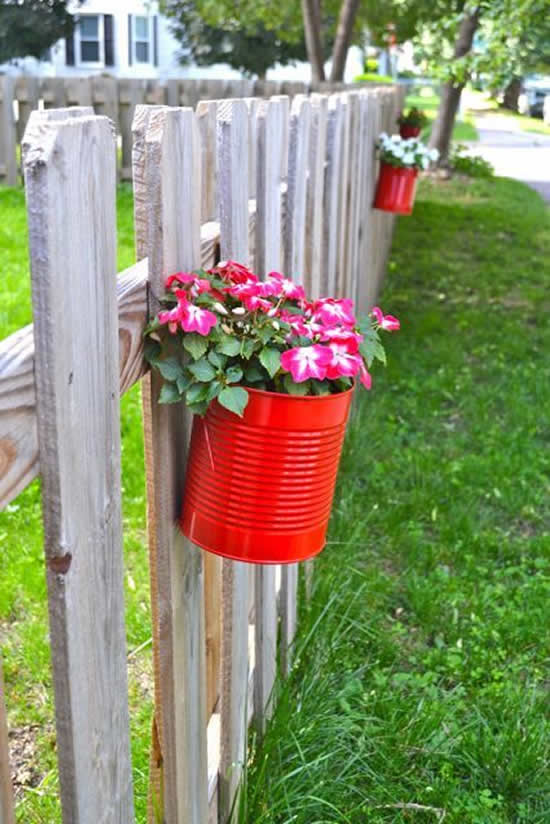 Beautiful hanging garden with cans